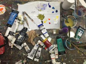 Top_view_of_watercolor_supplies_paints_and_brushes_enarliotis