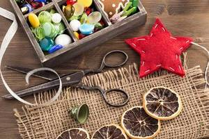46351005-hand-crafted-holiday-ornaments-and-vintage-scissors-top-view